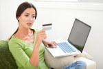 Young woman looking at her credit card