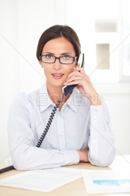 Adult businesswoman conversing on the phone