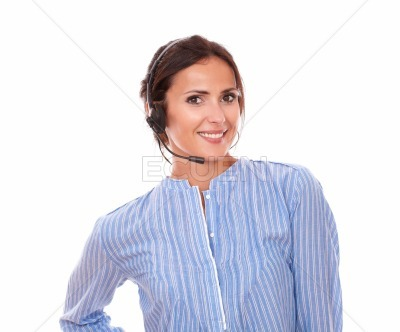 Adult latin female conversing with earphone
