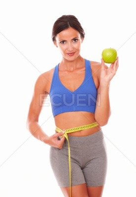 Adult sporty lady dieting on fruit