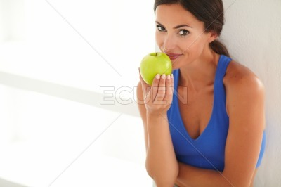 Adult woman in sports clothing holding food
