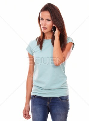 Angry adult brunette talking on her cell