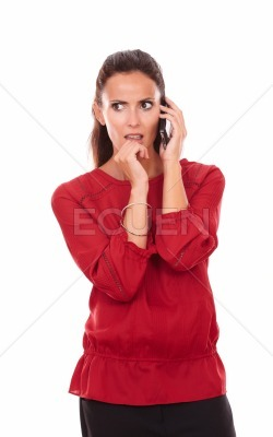 Angry hispanic lady talking on her cell