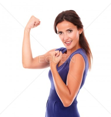 Attractive female with arms up celebrating