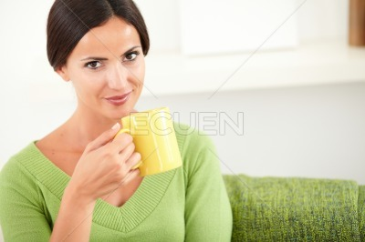 Attractive lady holding a yellow mug