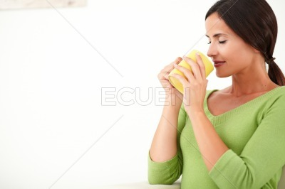 Attractive lady smelling a coffee cup