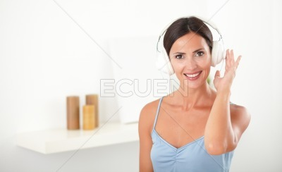 Attractive latin woman listening to music