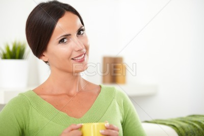 Attractive young person sitting down at indoors