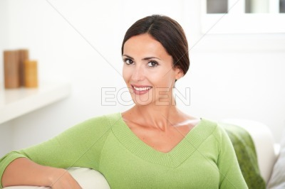 Beautiful caucasian woman smiling at indoors