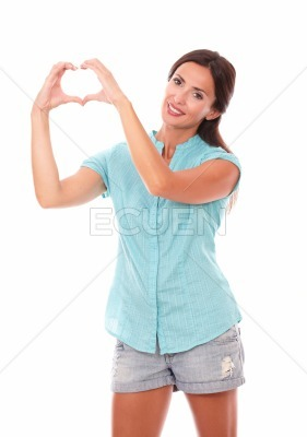 Beautiful girl making a love sign