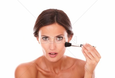 Beautiful hispanic woman applying beauty product