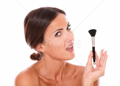 Beautiful woman with pampering make up brush