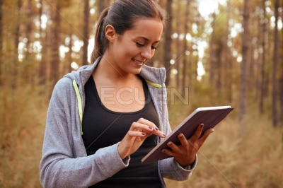 Beautiful young girl with her tablet