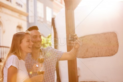 Beer dinking couple posing for selfie