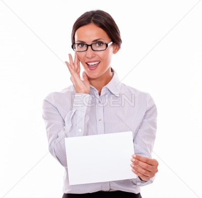 Brunette businesswoman with a blank signboard