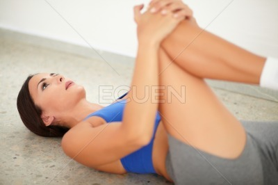 Brunette female exercising pilates for wellbeing