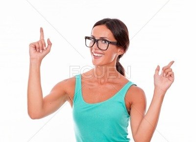 Brunette woman pointing with both hands