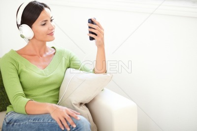 Carefree woman listening to music on headphones