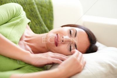 Carefree woman resting with her eyes closed