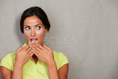 Caucasian ethnicity woman with hands to mouth