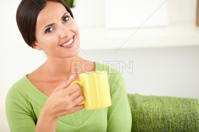Caucasian woman holding a coffee cup