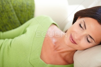 Caucasian woman resting with eyes closed
