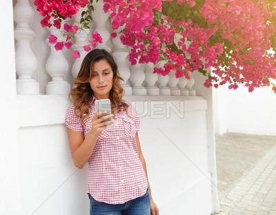 Caucasian woman texting on smart phone outdoors