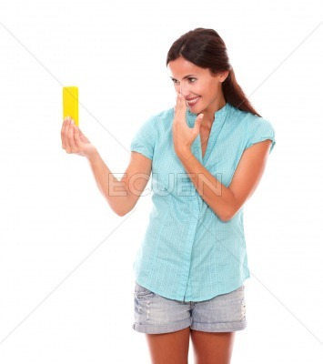 Charming young woman taking photos of herself