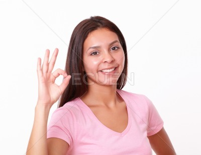 Cheerful young girl with positive gesture