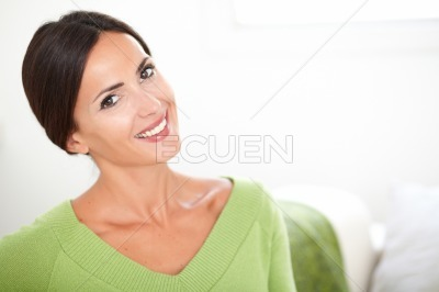 Cheerful young woman smiling at the camera
