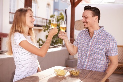 Couple raising and clinking their glasses
