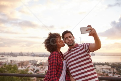 Couple taking selfie with a cellphone