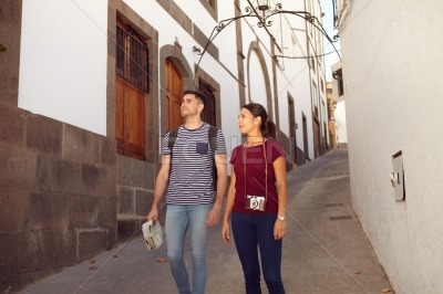 Couple walking down a narrow street