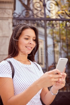 Cute girl looking at her cellphone