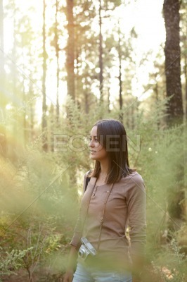 Cute smiling young girl in a forest