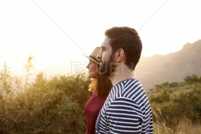 Cute young couple looking at something
