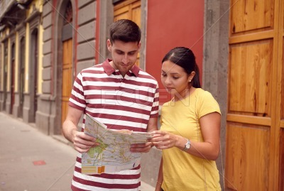 Cute young couple studying a map