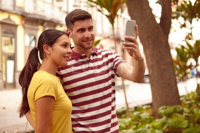 Cute young couple taking a selfie