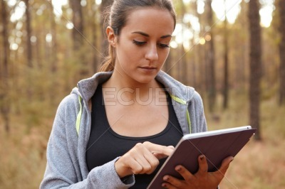 Cute young girl concentrating on tablet
