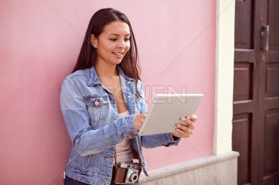 Cute young girl with a tablet pc