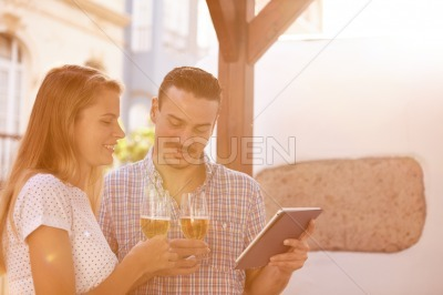 Dating couple with tablet and beers