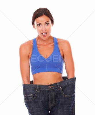 Dieting beautiful woman measuring body waist
