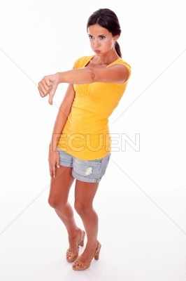 Disappointed brunette gesturing a thumbs down