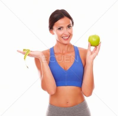Energetic sporty woman dieting on fruit