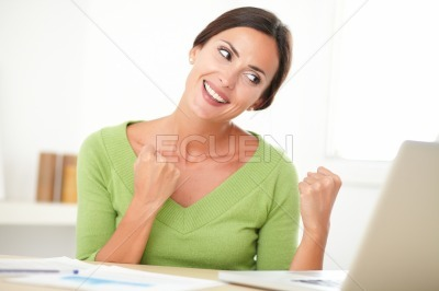 Excited female winner browsing the web
