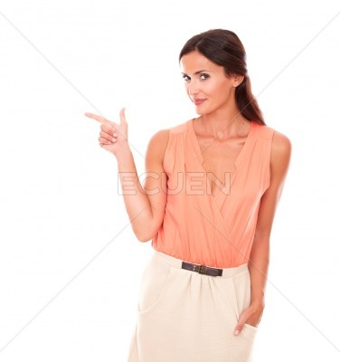 Fashionable lady pointing to her right