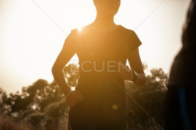 Female body with bright sun behind