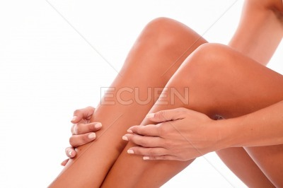 Female legs and hands on white
