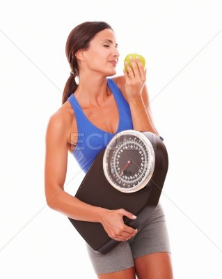 Female pretty adult dieting on fruits