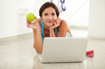 Fit hispanic woman using her laptop